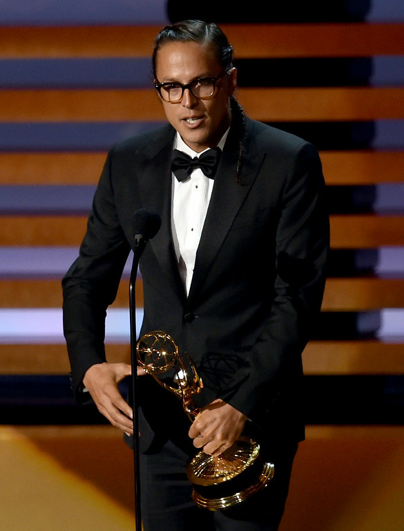 . Director Cary Joji Fukunaga accepts Outstanding Directing for a Drama Series for the \'True Detective\' episode \'Who Goes There\' onstage at the 66th Annual Primetime Emmy Awards held at Nokia Theatre L.A. Live on August 25, 2014 in Los Angeles, California.  (Photo by Kevin Winter/Getty Images)