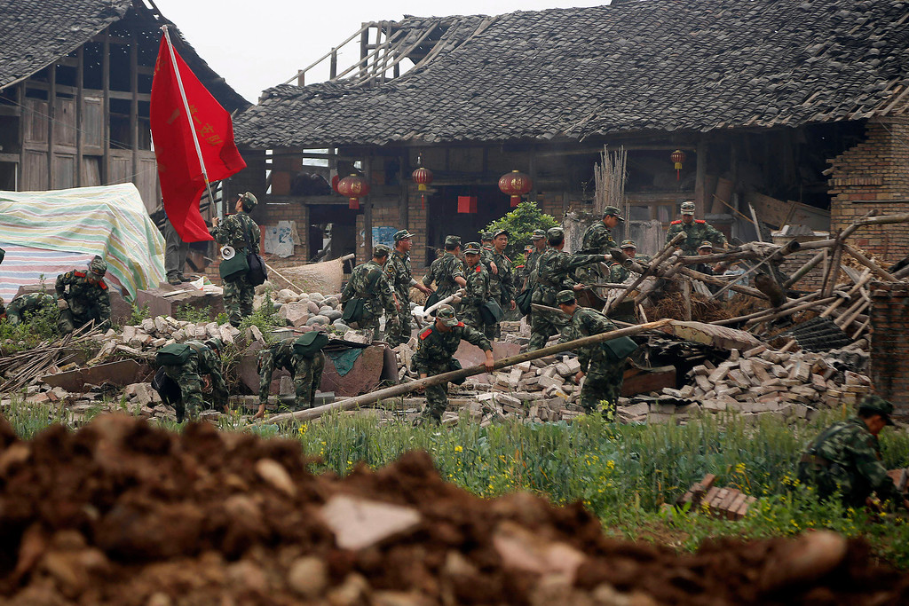 . Rescue workers search through the rubble of a building destroyed by an earthquake in Qingyuan village of Baoxing county in southwestern China\'s Sichuan province, Monday, April 22, 2013.  (AP Photo)