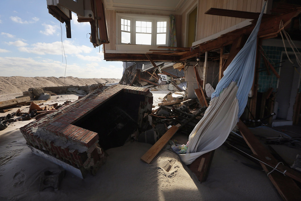 . The destroyed remains of a home sit in the sand on November 21, 2012 in Mantoloking, New Jersey. Mantoloking was one of the hardest hit areas by Superstorm Sandy.   (Photo by Mario Tama/Getty Images)