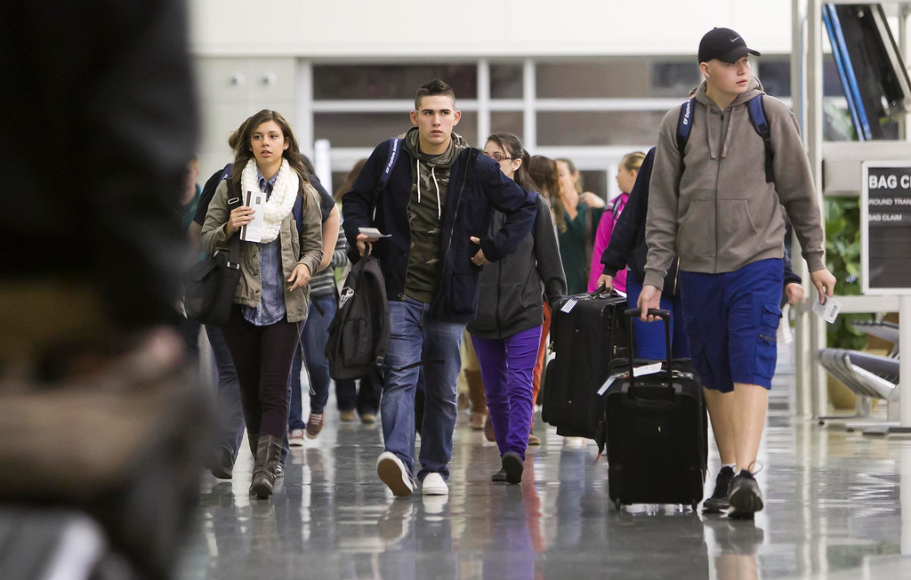 . A group of Nampa High students check their luggage and prepare for a trip to Washington, D.C. before dawn Wednesday Oct. 2, 2013 at the Boise Airport. The students belong to a travel club and have been planning the trip for over a year, but the recent government shutdown of many of the sites they are planning to see will not be open. (AP Photo/The Idaho Statesman, Darin Oswald)
