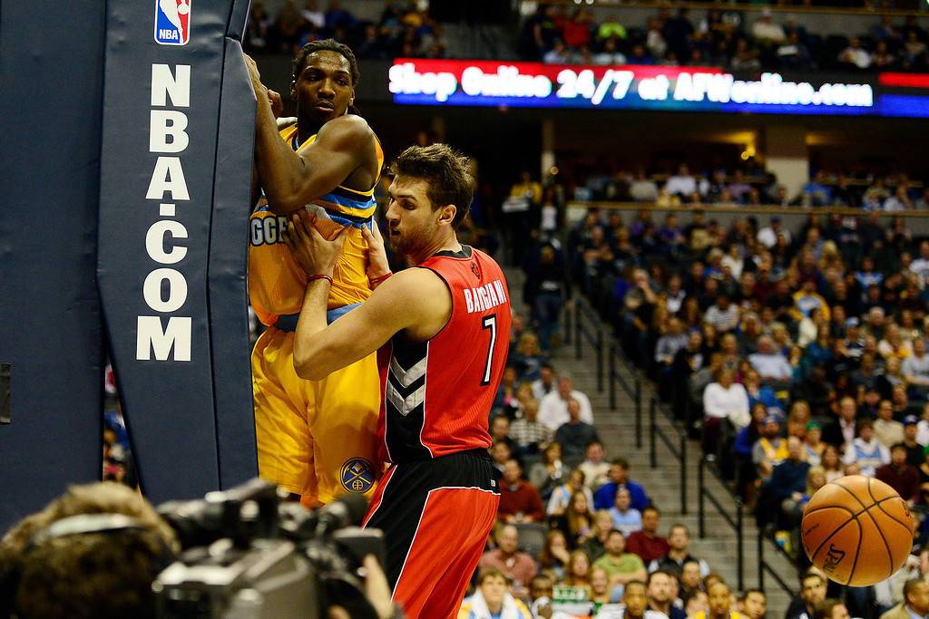 . Denver Nuggets small forward Kenneth Faried (35) is pressed against the base of the basket by Toronto Raptors center Andrea Bargnani (7) during the first half at the Pepsi Center on Monday, December 3, 2012. AAron Ontiveroz, The Denver Post