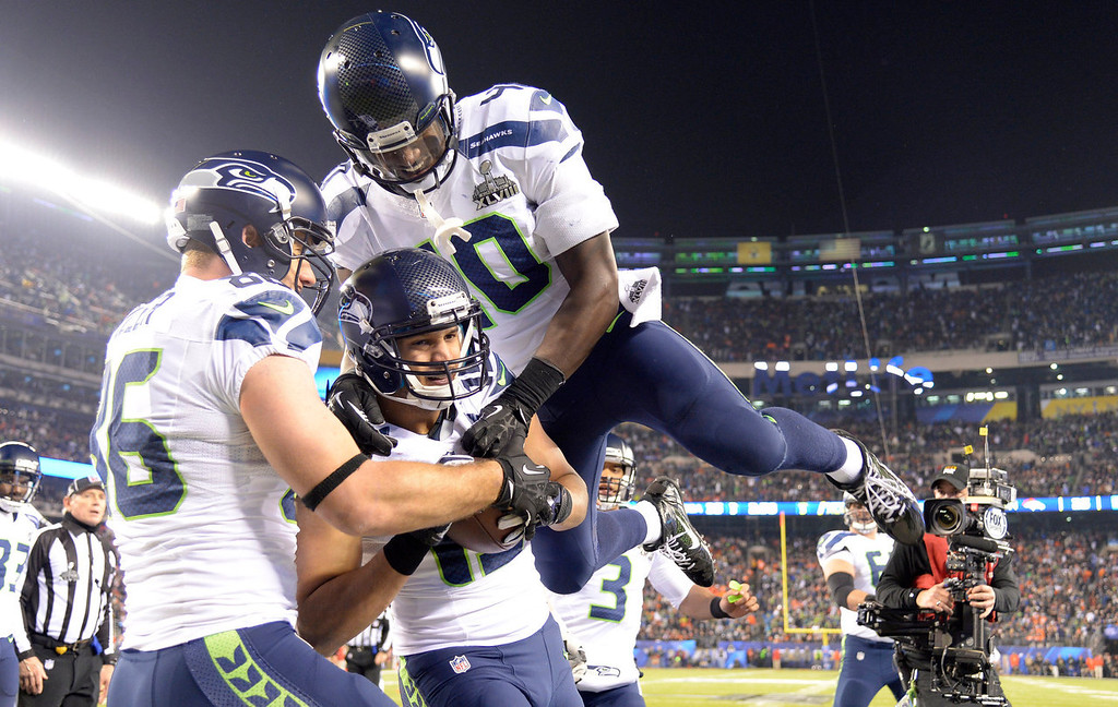 . Seattle Seahawks wide receiver Jermaine Kearse (15) gets  congratulated by teammates after scoring a touchdown during the third quarter. The Denver Broncos vs the Seattle Seahawks in Super Bowl XLVIII at MetLife Stadium in East Rutherford, New Jersey Sunday, February 2, 2014. (Photo by Joe Amon/The Denver Post)