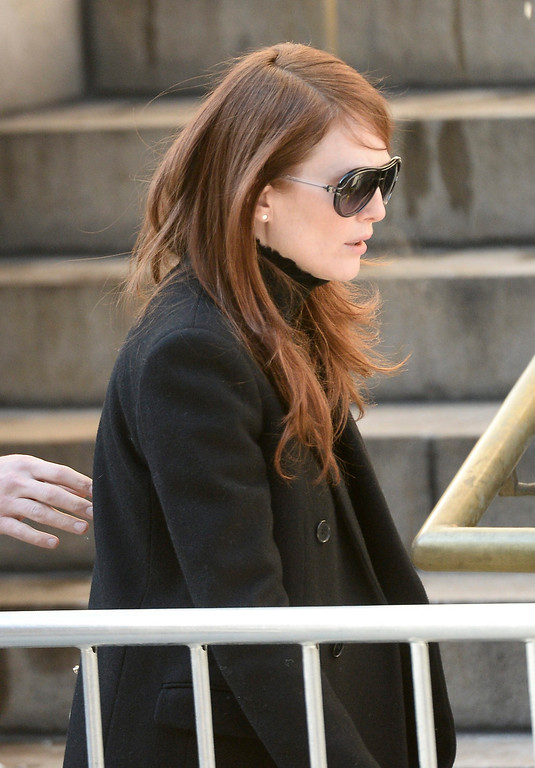 . US actress Julianne Moore arrives for the Funeral Mass for US Actor Phillip Seymour Hoffman at St Ignatius Church in New York, New York, USA 07 February 2014. Hoffman, 46, died 02 February from a suspected drug overdose.  EPA/ANDREW GOMBERT