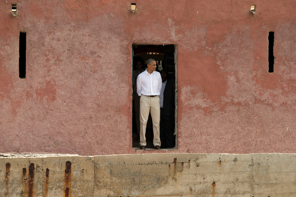 . U.S. President Barack Obama stands facing out to sea,  at the \'Door of No Return,\' at the slave house on Goree Island, in Dakar, Senegal, Thursday, June 27, 2013. Obama called his visit to a Senegalese island from which Africans were said to have been shipped across the Atlantic Ocean into slavery, a \'very powerful moment.\' President Obama was in Dakar as part of a weeklong trip to Africa, a three-country visit aimed at overcoming disappointment on the continent over the first black U.S. president\'s lack of personal engagement during his first term. (AP Photo/Rebecca Blackwell)