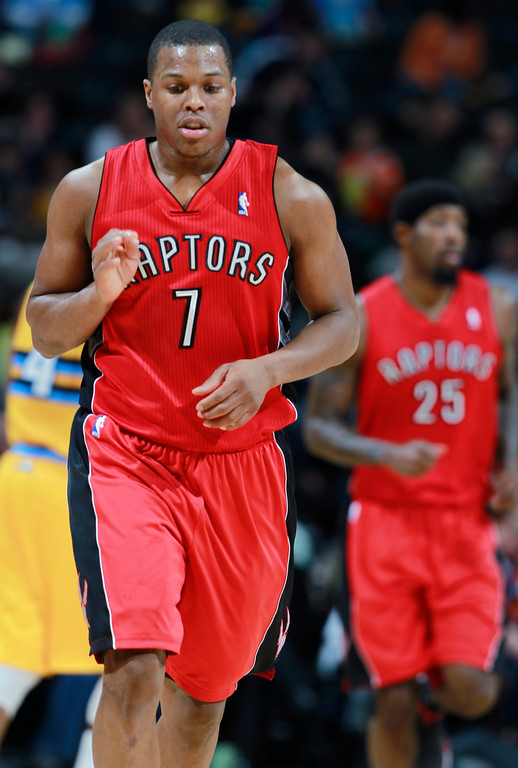 . Toronto Raptors guard Kyle Lowry reacts after hitting a basket to give the Raptors a 16-point lead late in the third quarter of the Raptors\' 100-90 victory over the Denver Nuggets in an NBA basketball game in Denver, Friday, Jan. 31, 2014. (AP Photo/David Zalubowski)