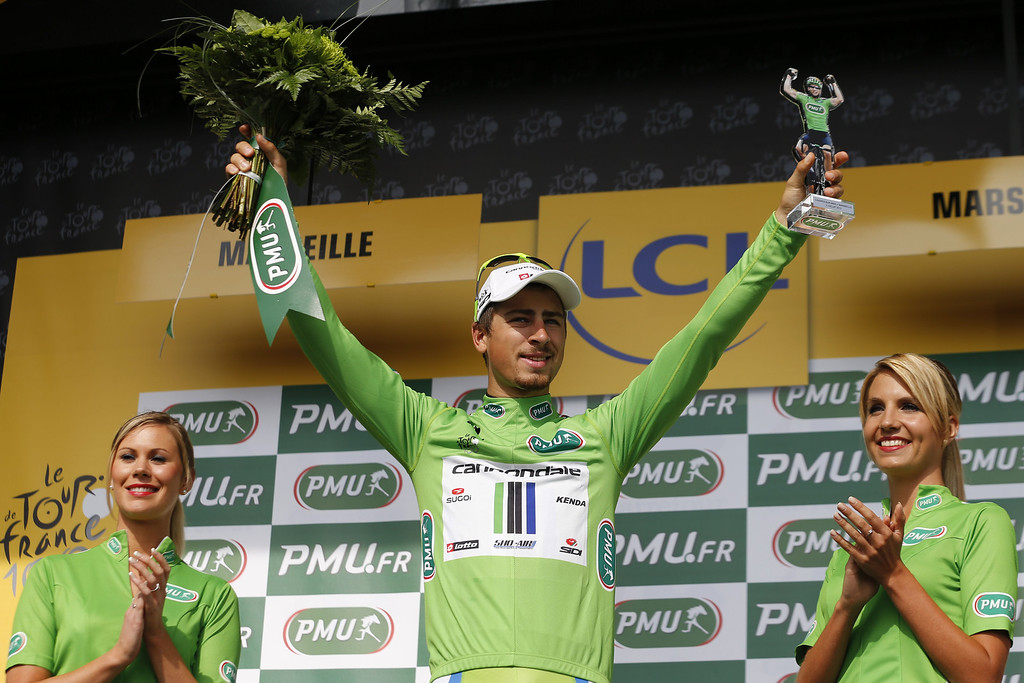 . Slovakia\'s Peter Sagan celebrates his green jersey of best sprinter on the podium at the end of the 228.5 km fifth stage of the 100th edition of the Tour de France cycling race on July 3, 2013 between Cagnes-sur-Mer and Marseille, southern France.  AFP PHOTO / PASCAL  GUYOT/AFP/Getty Images
