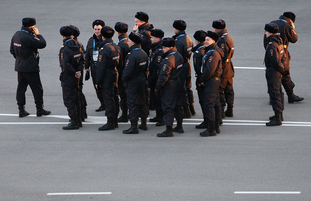 . Russian policemen stand outside the Shayba arena prior to the start of the 2014 Sochi Winter Olympics on January 4, 2014. The opening ceremony of the Sochi Olympic Winter will take place on February 7, 2014. AFP PHOTO/LOIC VENANCE/AFP/Getty Images