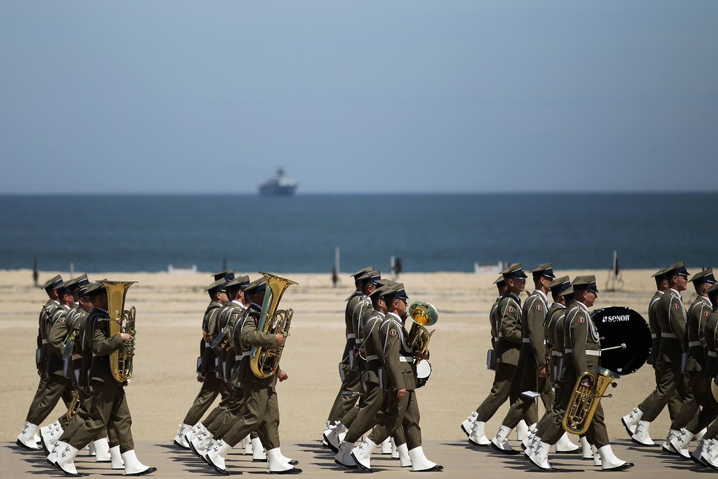 . A fanfare parades prior to the start of the international D-Day commemoration ceremony on the beach of Ouistreham, Normandy, on June 6, 2014, marking the 70th anniversary of the World War II Allied landings in Normandy.  AFP PHOTO / CHARLY TRIBALLEAU/AFP/Getty Images