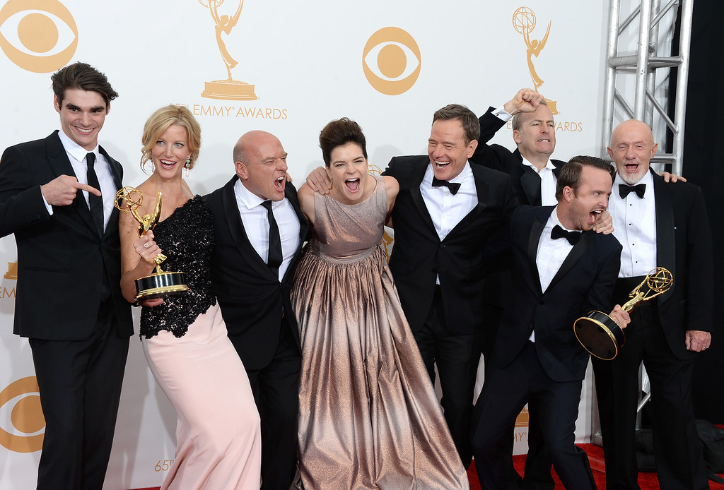 """. (L-R) Actors RJ Mitte, Anna Gunn, Dean Norris, Betsy Brandt, Bryan Cranston, Aaron Paul, Bob Odenkirk and Jonathan Banks, winners of the Best Drama Series Award for \""""Breaking Bad,\"""" pose in the press room during the 65th Annual Primetime Emmy Awards held at Nokia Theatre L.A. Live on September 22, 2013 in Los Angeles, California.  (Photo by Jason Merritt/Getty Images)"""