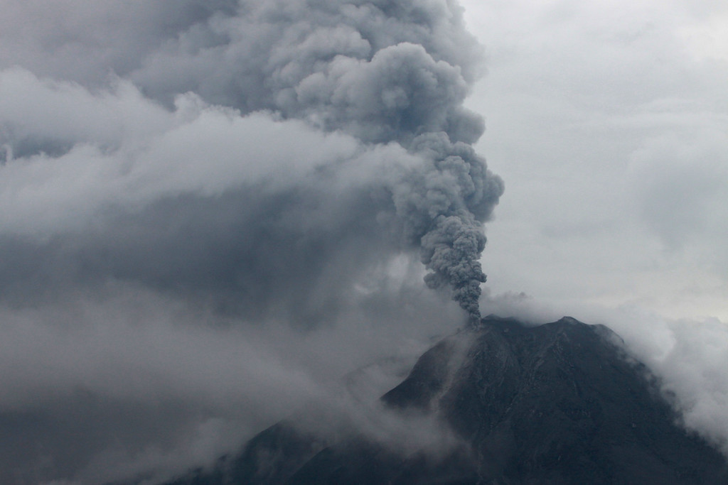 . Mount Sinabung spews volcanic ash as it erupts as seen from Simpang Empat, North Sumatra, Indonesia, Sunday, Nov. 3, 2013. Officials raised the volcano\'s alert status to the second-highest level after the 2,600-meter (8,530-foot) -high mountain erupted early Sunday. (AP Photo/Ade Sinuhaji)