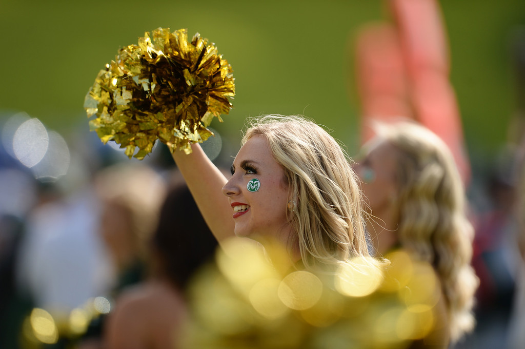 . FORT COLLINS, CO - OCTOBER 12 : Colorado State cheerleaders root from the slideline during the game against San Jose State at Hughes Stadium. Fort Collins. Colorado. October 12, 2013. San Jose won 34-27. (Photo by Hyoung Chang/The Denver Post)