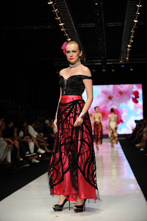 . A model showcases designs by Kanaya Tabitha on the runway at the Indonesian Fashion Designer Council show during Jakarta Fashion Week 2014 at Senayan City on October 21, 2013 in Jakarta, Indonesia.  (Photo by Robertus Pudyanto/Getty Images)