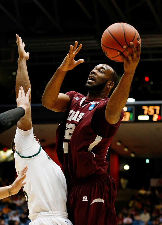 . DAYTON, OH - MARCH 19: Aaron Clayborn #32 of the Texas Southern Tigers goes to the basket against the Cal Poly Mustangs during the first round of the 2014 NCAA Men\'s Basketball Tournament at UD Arena on March 19, 2014 in Dayton, Ohio.  (Photo by Gregory Shamus/Getty Images)