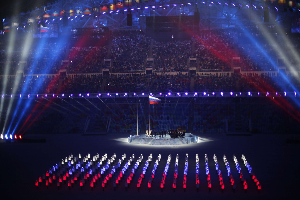 . The Russian flag is flutters as a representation of the national flag is presented during the Opening Ceremony of the Sochi Winter Olympics at the Fisht Olympic Stadium on February 7, 2014 in Sochi. AFP PHOTO / ADRIAN DENNIS/AFP/Getty Images