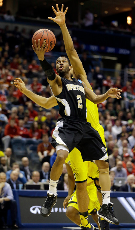 . Wofford guard Karl Cochran (2) goes to the basket against Michigan forward Jon Horford during the first half of a second round NCAA college basketball tournament game Thursday, March 20, 2014, in Milwaukee. (AP Photo/Jeffrey Phelps)