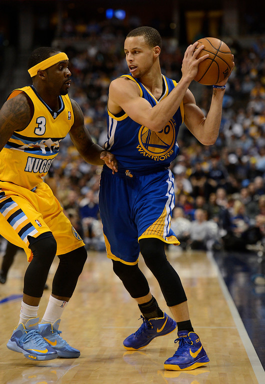 . DENVER, CO. - APRIL 23: Golden State Warriors point guard Stephen Curry (30) is guarded by Denver Nuggets point guard Ty Lawson (3) in the third quarter. The Denver Nuggets took on the Golden State Warriors in Game 2 of the Western Conference First Round Series at the Pepsi Center in Denver, Colo. on April 23, 2013. (Photo by John Leyba/The Denver Post)