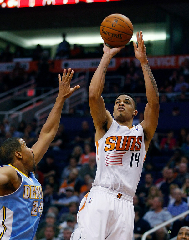 . Phoenix Suns shooting guard Gerald Green (14), right, shoots over Denver Nuggets point guard Andre Miller (24) in the third quarter during an NBA basketball game on Friday, Nov. 8, 2013, in Phoenix. The Suns defeated the Nuggets 114-93. (AP Photo/Rick Scuteri)