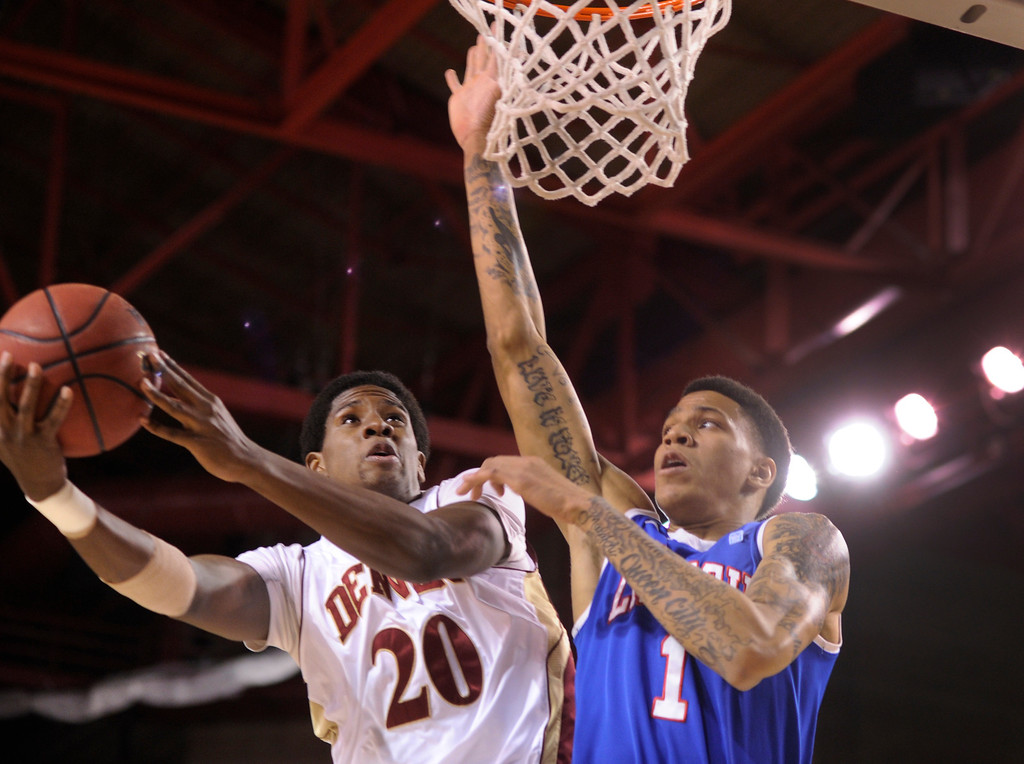. Bulldogs forward Michale Kyser (1) challenged Pioneers forward Royce O\'Neale (20) on the way to the hoop in the first half. The University of Denver men\'s basketball team hosted the Louisiana Tech Bulldogs at Magness Arena Saturday night, March 9, 2013. (Photo By Karl Gehring/The Denver Post)