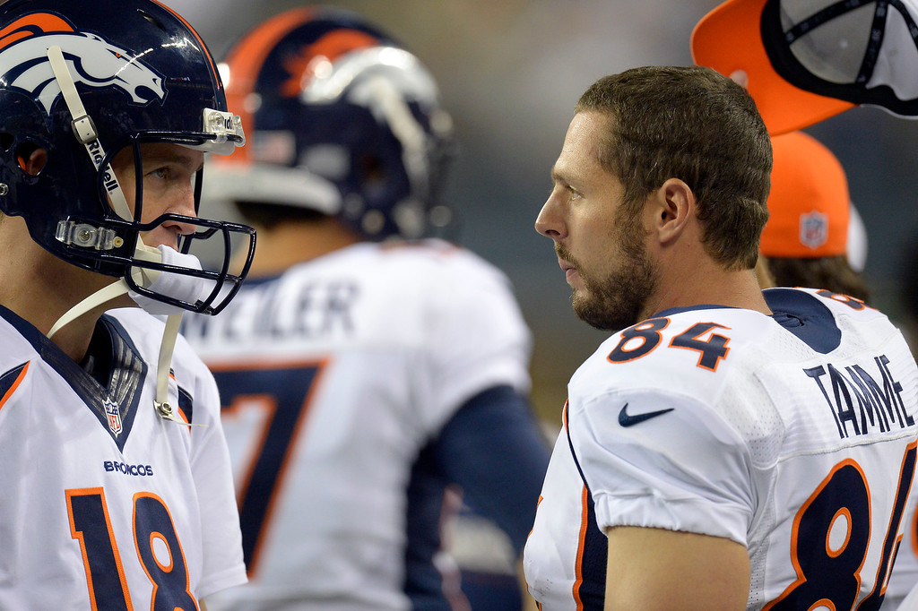 . SEATTLE, WA. - AUGUST 17: Denver Broncos quarterback Peyton Manning (18) talks with Denver Broncos tight end Jacob Tamme (84) on the bench August 17, 2013 at Century Link Field. (Photo By John Leyba/The Denver Post)