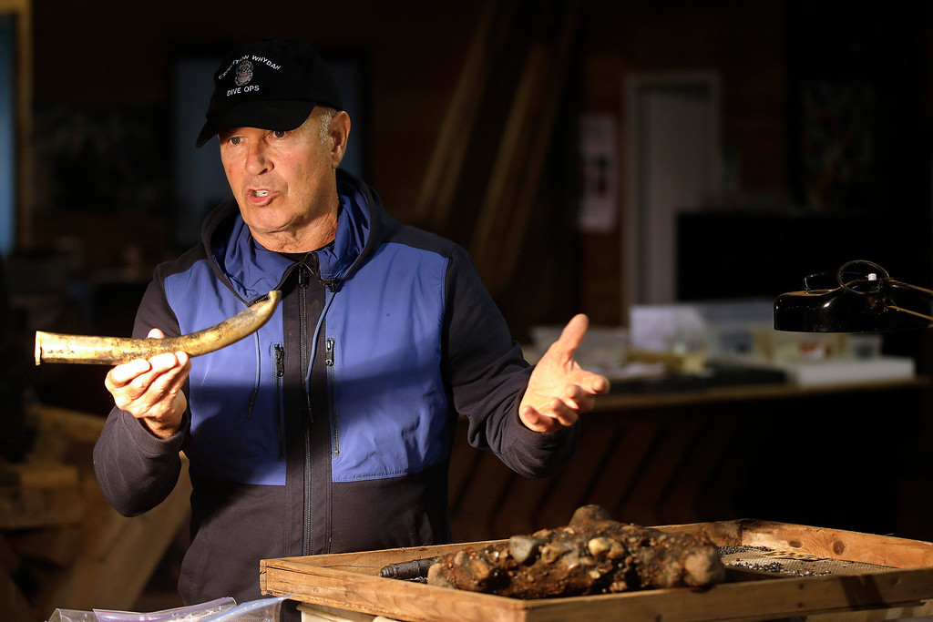 ". Underseas explorer Barry Clifford holds the barrel of a partially crushed blunderbuss he salvaged from the wreck of pirate ship ""Whydah\"" during a video interview in Brewster, Mass., Tuesday, Sept. 17, 2013.  (AP Photo/Stephan Savoia)"