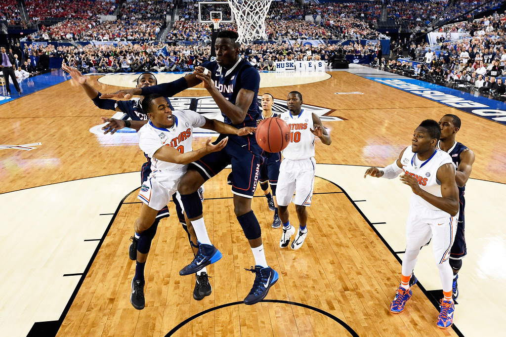 . ARLINGTON, TX - APRIL 05: Kasey Hill #0 of the Florida Gators goes to the basket as Amida Brimah #35 of the Connecticut Huskies defends during the NCAA Men\'s Final Four Semifinal at AT&T Stadium on April 5, 2014 in Arlington, Texas. (Photo by Chris Steppig-Pool/Getty Images)