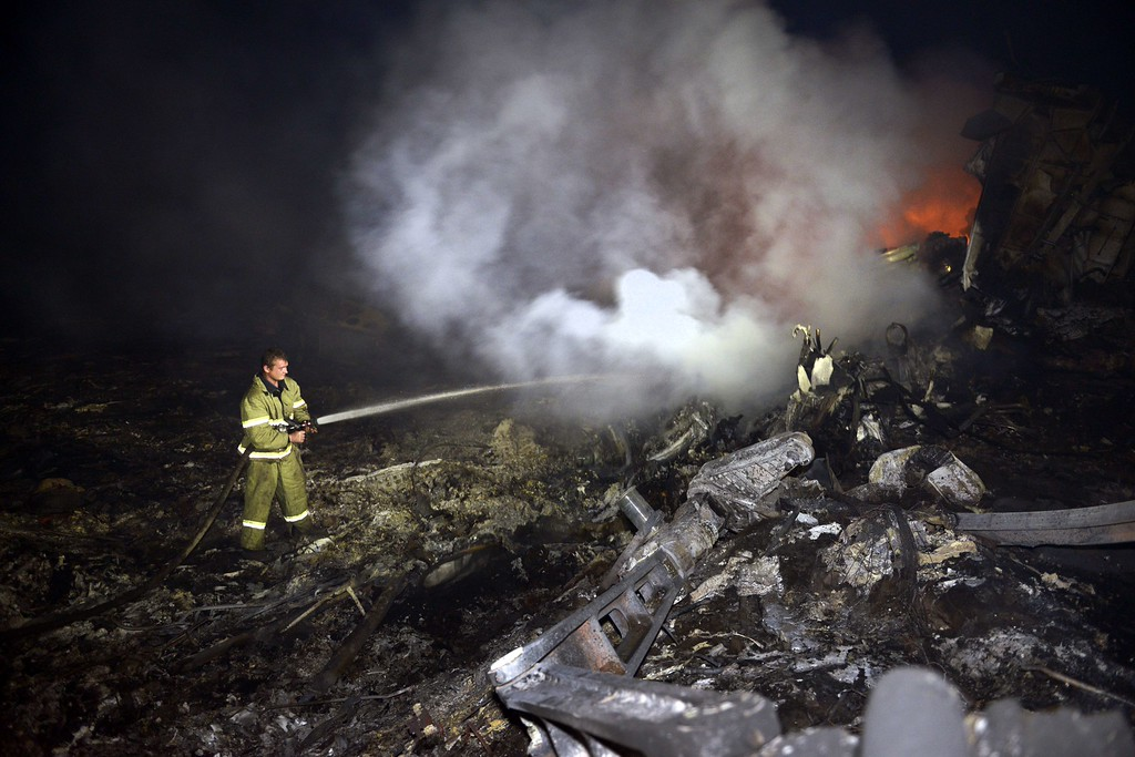 ". A firefighter sprays water to extinguish a fire, on July 17, 2014, amongst the wreckages of the malaysian airliner carrying 295 people from Amsterdam to Kuala Lumpur after it crashed, near the town of Shaktarsk, in rebel-held east Ukraine. Ukrainian President Petro Poroshenko said on Thursday that the Malaysia Airlines jet that crashed over rebel-held eastern Ukraine may have been shot down.""We do not exclude that the plane was shot down and confirm that the Ukraine Armed Forces did not fire at any targets in the sky,\"" Poroshenko said in a statement posted on the president\'s website. AFP PHOTO/ ALEXANDER  KHUDOTEPLY/AFP/Getty Images"