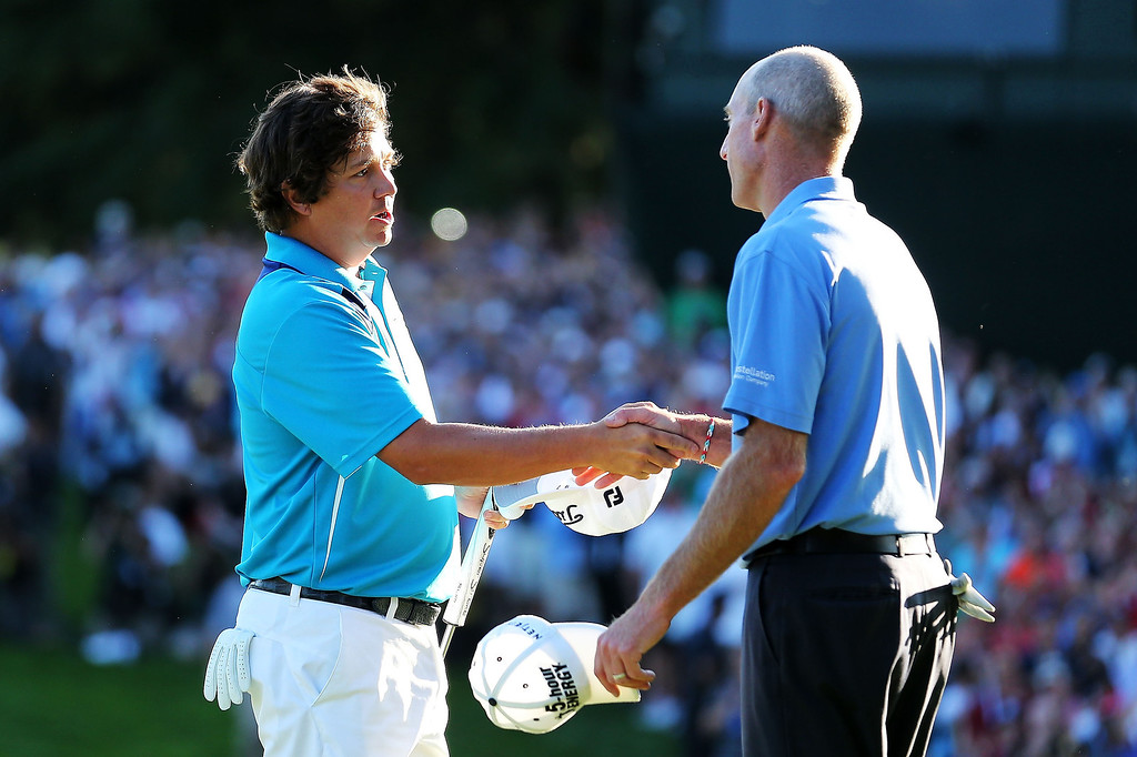 . Jason Dufner of the United States is congratulated by playing partner Jim Furyk on the 18th green after his two-stroke victory at the 95th PGA Championship at Oak Hill Country Club on August 11, 2013 in Rochester, New York.  (Photo by Rob Carr/Getty Images)