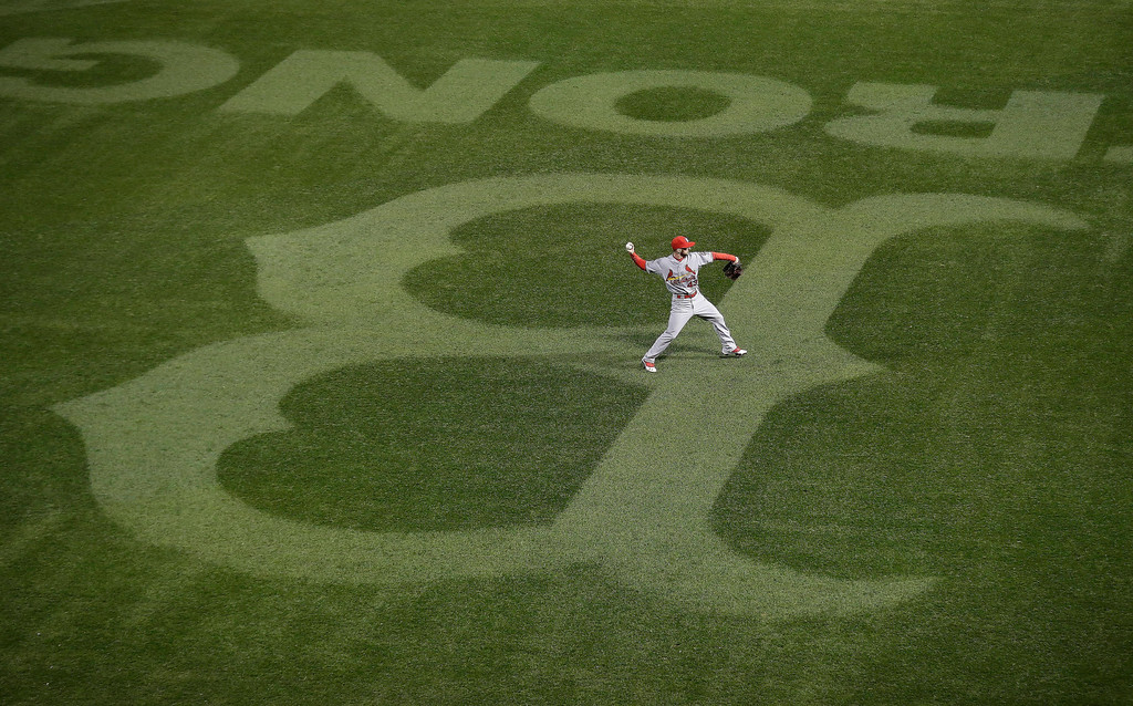 . St. Louis Cardinals\' Shane Robinson warms up during the first inning of Game 1 of baseball\'s World Series against the Boston Red Sox Wednesday, Oct. 23, 2013, in Boston. (AP Photo/Charlie Riedel)