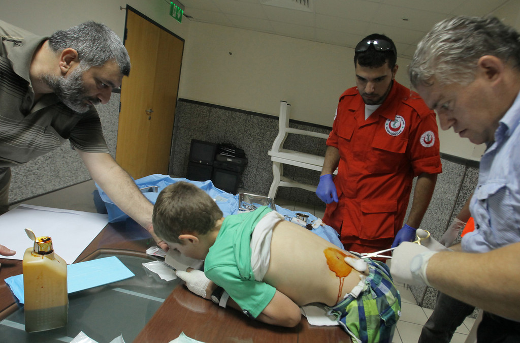 . A young boy receives medical treatment at a hospital following two powerful explosions in the northern Lebanese city of Tripoli on August 23, 2013.    AFP PHOTO / STRSTR/AFP/Getty Images
