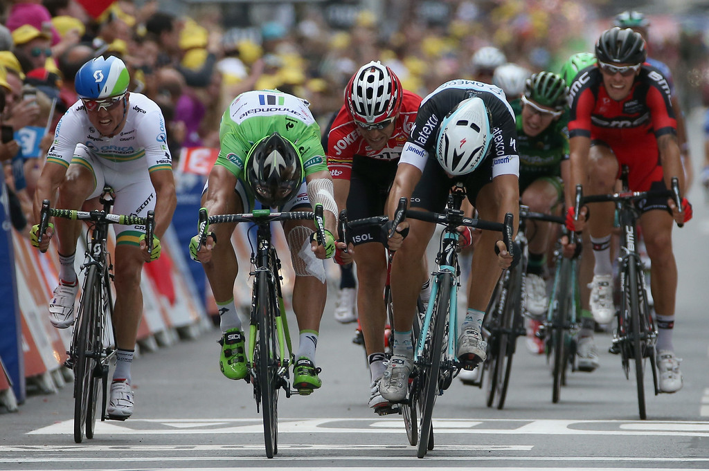 . Matteo Trentin (R) of Italy and the Omega Pharma - Quick-Step Cycling Team throws his bike across the line to beat Peter Sagan (L) of Slovakia and Cannondale to win stage seven of the 2014 Le Tour de France from Epernay to Nancy on July 11, 2014 in Nancy, France.  (Photo by Doug Pensinger/Getty Images)