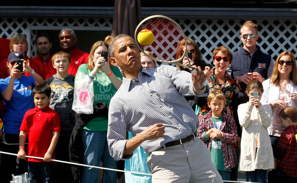 . U.S. President Barack Obama plays tennis during the 135th annual Easter Egg Roll on the South Lawn of the White House in Washington, April 1, 2013. REUTERS/Jason Reed
