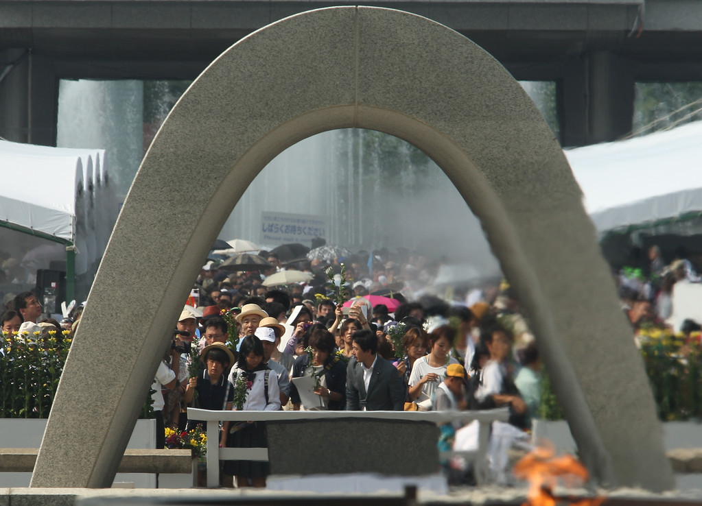 . Japanese people pray in front of a monument for atomic bomb victims at the Hiroshima Peace Memorial Park on the day of the 68th anniversary of the atomic bombing of Hiroshima on August 6, 2013 in Hiroshima, Japan. (Photo by Buddhika Weerasinghe/Getty Images)