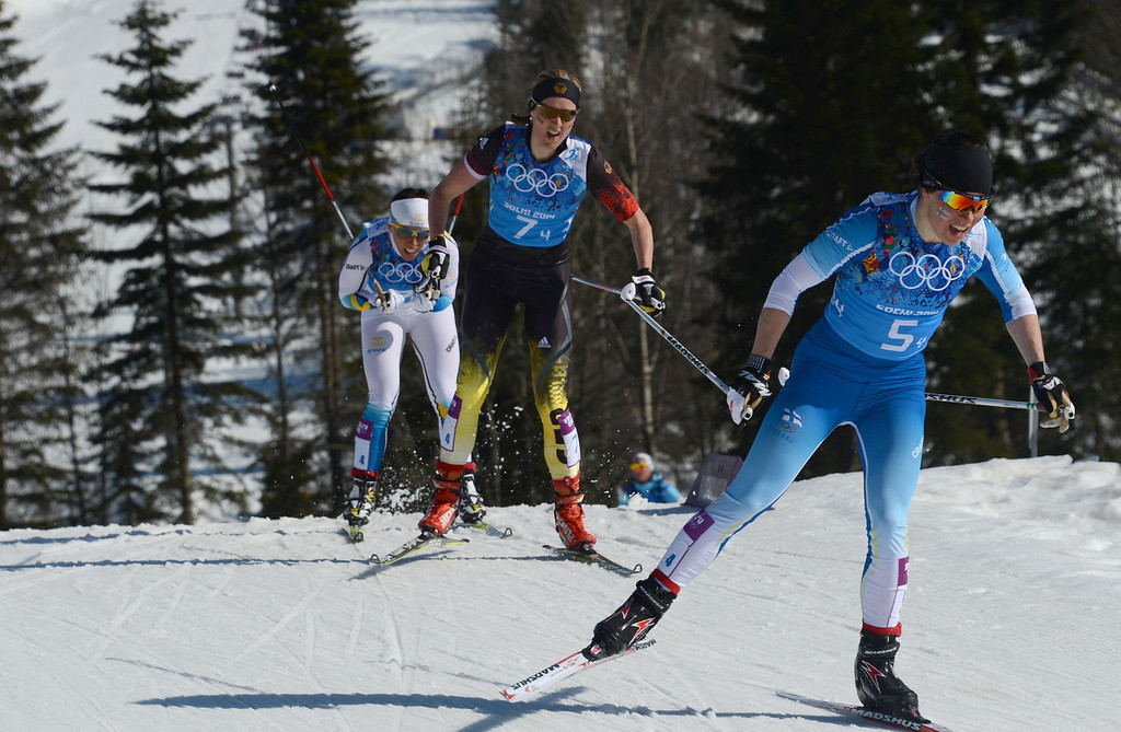 . Finland\'s Krista Lahteenmaki (R) is followed by Germany\'s Denise Herrmann and Sweden\'s Charlotte Kalla in the Women\'s Cross-Country Skiing 4x5km Relay at the Laura Cross-Country Ski and Biathlon Center during the Sochi Winter Olympics on February 15, 2014, in Rosa Khutor, near Sochi. Sweden won the gold Medal, Finland won Silver and Germany Bronze. KIRILL KUDRYAVTSEV/AFP/Getty Images