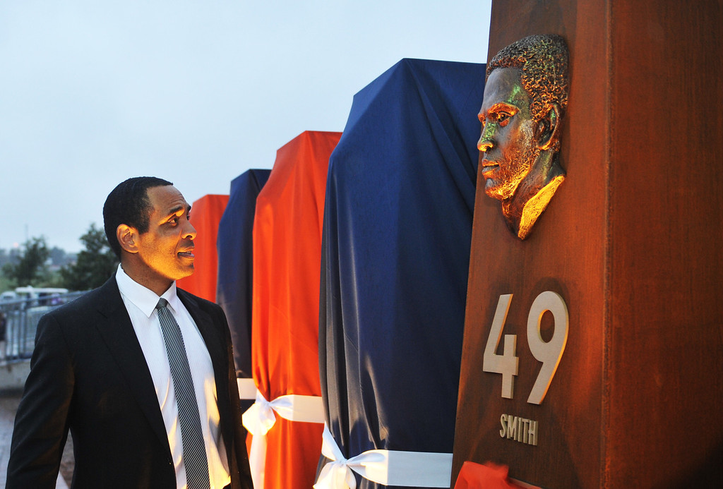 . DENVER, CO - September 27 : Safety Dennis Smith checks out his sculpture at the Denver Broncos Ring of Fame Plaza in Sports Authority Field at Mile High. Denver, Colorado. September 27, 2013. The Plaza features pillars honoring each of the 24 players in the Broncos� Ring of Fame. (Photo by Hyoung Chang/The Denver Post)