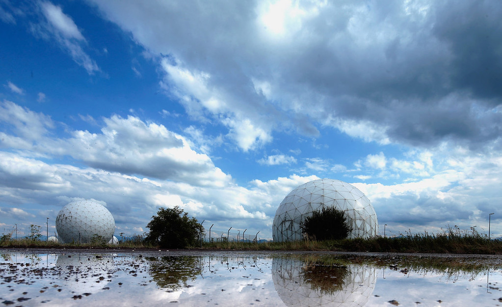 . Radomes that contain radar antennas stand at an operating facility of the Bundesnachrichtendienst, or BND, the main German foreign intelligence gathering agency, on August 11, 2013 near Bad Aibling, Germany. The German government recently confirmed that the BND shares large amounts of its data with the NSA, and according to former NSA employee Edward Snowden, NSA operatives work at the Bad Aibling BND facility. The NSA surveillance scandal has become a hot political topic in Germany six weeks ahead of federal elections.  (Photo by Johannes Simon/Getty Images)
