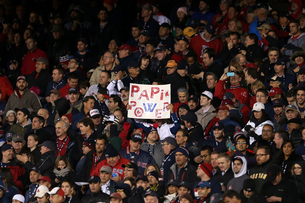 . BOSTON, MA - OCTOBER 24: A fan holds a sign in support of David Ortiz #34 of the Boston Red Sox during Game Two of the 2013 World Series between the Boston Red Sox and the St. Louis Cardinals at Fenway Park on October 24, 2013 in Boston, Massachusetts.  (Photo by Rob Carr/Getty Images)