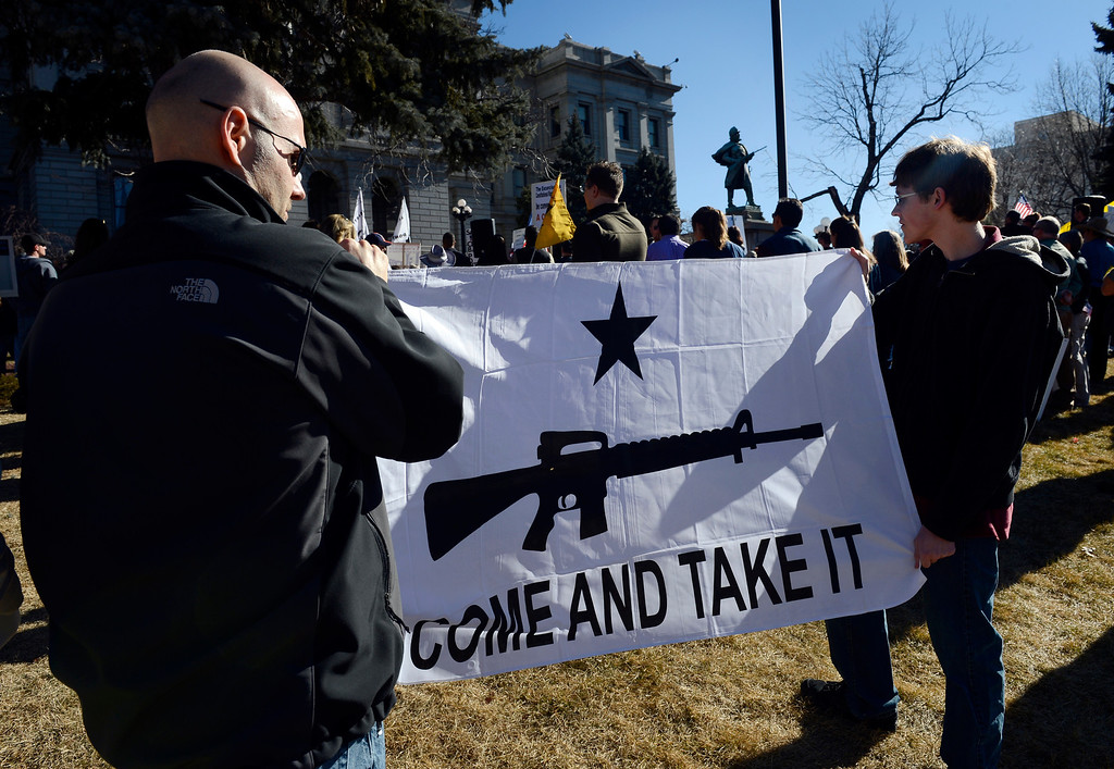 . DENVER, CO. - JANUARY  19: Two men, (who chose not to be identified), hold a banner supporting gun rights at a pro gun rally at the Colorado State Capitol Saturday afternoon, January 19th, 2013.  (Photo By Andy Cross / The Denver Post)
