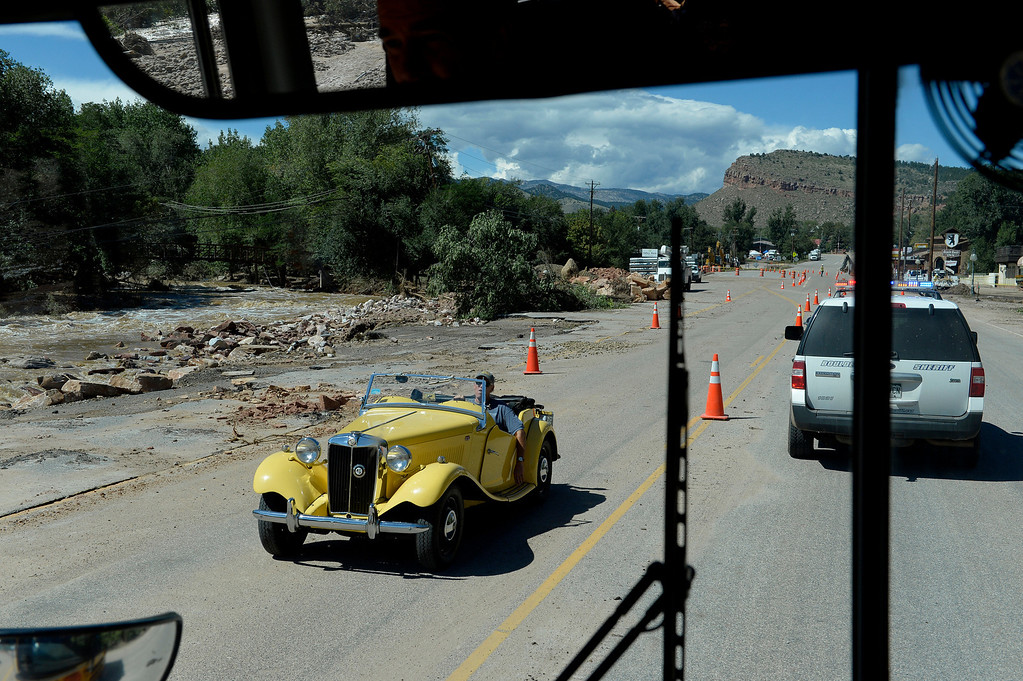 . LYONS, CO. - SEPTEMBER 18: A man drives an MG highway 66, departing Lyons,  CO September 18, 2013. Business owners were allowed to return to town today and residents will be allowed to visit their homes tomorrow. As emergency personnel methodically make their way from door-to-door of flooded and damaged homes this week, the number of unaccounted-for Coloradans is dropping. The number in Boulder County has fallen to four. (Photo By Craig F. Walker / The Denver Post)