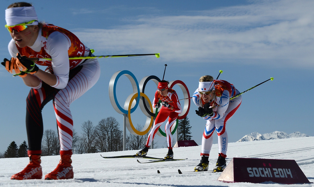 . (From L) Austria\'s Katerina Smutna, Poland\'s Kornelia Kubinska and France\'s Aurore Jean  compete in the Women\'s Cross-Country Skiing 4x5km Relay at the Laura Cross-Country Ski and Biathlon Center during the Sochi Winter Olympics on February 15, 2014, in Rosa Khutor, near Sochi. KIRILL KUDRYAVTSEV/AFP/Getty Images