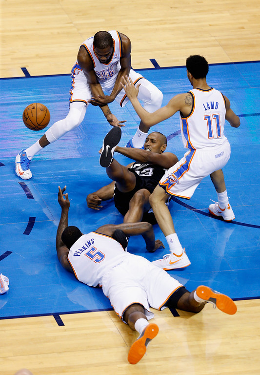 . OKLAHOMA CITY, OK - MAY 27: Boris Diaw #33 of the San Antonio Spurs fights for a loose ball with Kendrick Perkins #5, Kevin Durant #35 and Jeremy Lamb #11 of the Oklahoma City Thunder in the first quarter during Game Four of the Western Conference Finals of the 2014 NBA Playoffs at Chesapeake Energy Arena on May 27, 2014 in Oklahoma City, Oklahoma. (Photo by Joe Robbins/Getty Images)
