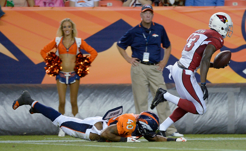 . Jaron Brown (13) of the Arizona Cardinals beats Aaron Hester (40) of the Denver Broncos for a touchdown catch during the last pre-season game of the season at Sports Authority Field at Mile High. August 29, 2013 Denver, Colorado. (Photo By Joe Amon/The Denver Post)