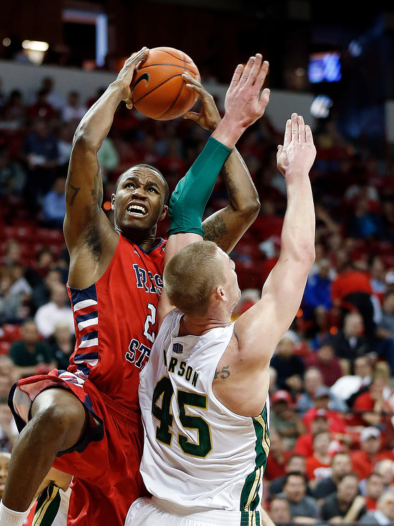 . Fresno State\'s Braeden Anderson shoots over Colorado State\'s Colton Iverson during the first half of a Mountain West Conference tournament NCAA college basketball game on Wednesday, March 13, 2013, in Las Vegas. (AP Photo/Isaac Brekken)