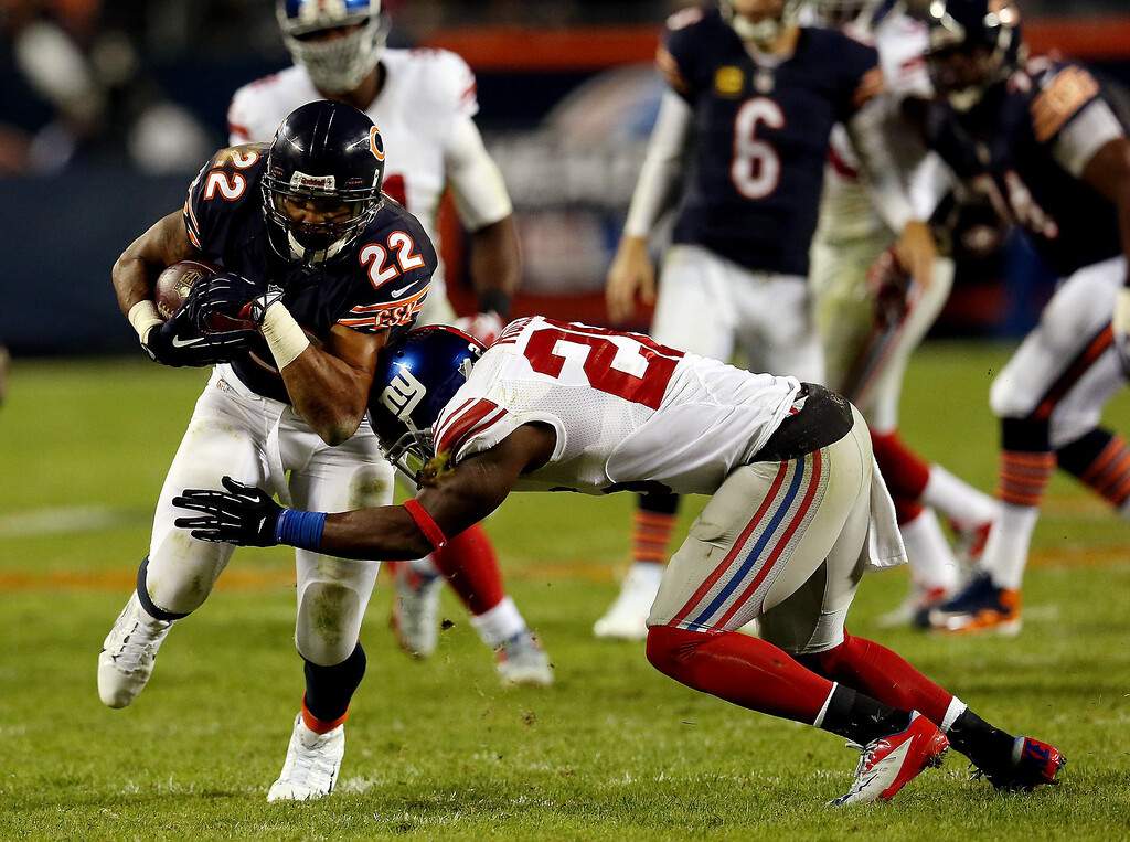 . Running back Matt Forte #22 of the Chicago Bears is tackled by strong safety Antrel Rolle #26 of the New York Giants during a game at Soldier Field on October 10, 2013 in Chicago, Illinois.  (Photo by Jonathan Daniel/Getty Images)
