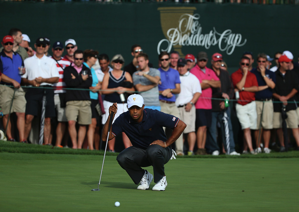 . DUBLIN, OH - OCTOBER 03:  Tiger Woods of the U.S. Team lines up a putt on the tenth green during the Day One Four-Ball Matches at the Muirfield Village Golf Club on October 3, 2013  in Dublin, Ohio.  (Photo by Andy Lyons/Getty Images)