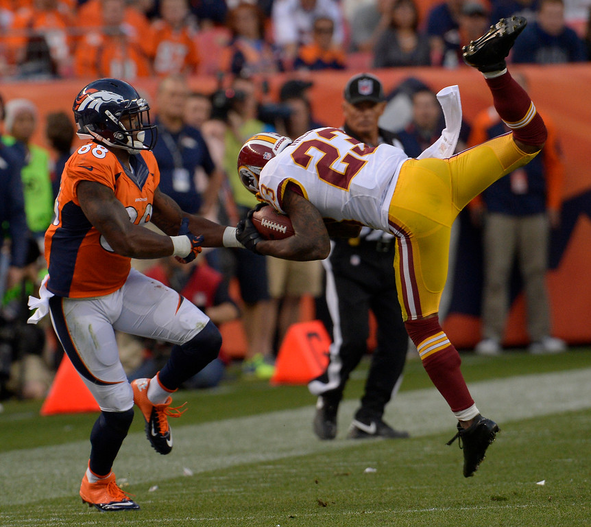 . Washington Redskins cornerback DeAngelo Hall (23) intercepts a pass intended for Denver Broncos wide receiver Demaryius Thomas (88) in the fourth quarter. The Denver Broncos take on the Washington Redskins at Sports Authority Field at Mile High in Denver on October 27, 2013. (Photo by Joe Amon/The Denver Post)