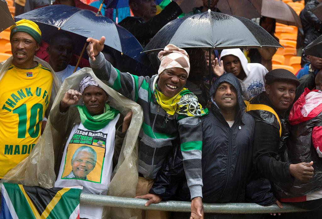 . People cheer as President Barack Obama speaks to crowds attending the memorial service for former South African president Nelson Mandela at the FNB Stadium in Soweto near Johannesburg, Tuesday, Dec. 10, 2013. World leaders, celebrities, and citizens from all walks of life gathered on Tuesday to pay respects during a memorial service for the former South African president and anti-apartheid icon. (AP Photo/Evan Vucci)