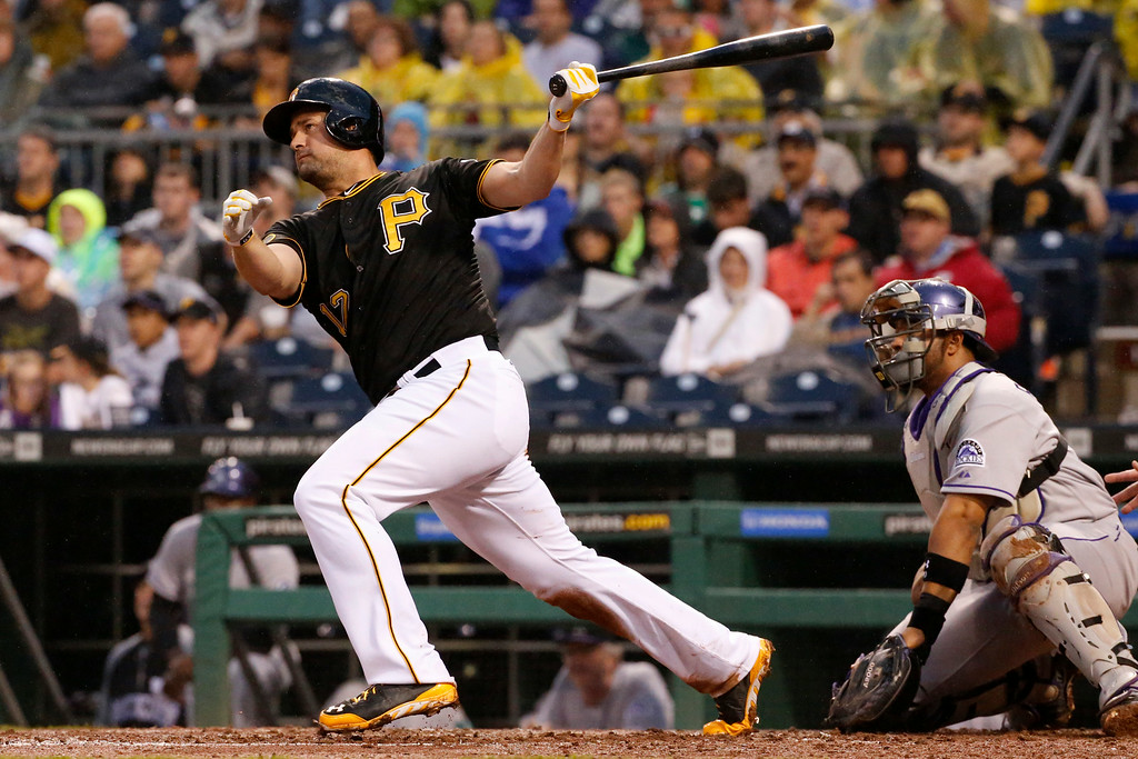 . Pittsburgh Pirates\' Gaby Sanchez drives in a run with a double off Colorado Rockies starting pitcher Brett Anderson during the fourth inning of a baseball game in Pittsburgh Saturday, July 19, 2014. (AP Photo/Gene J. Puskar)