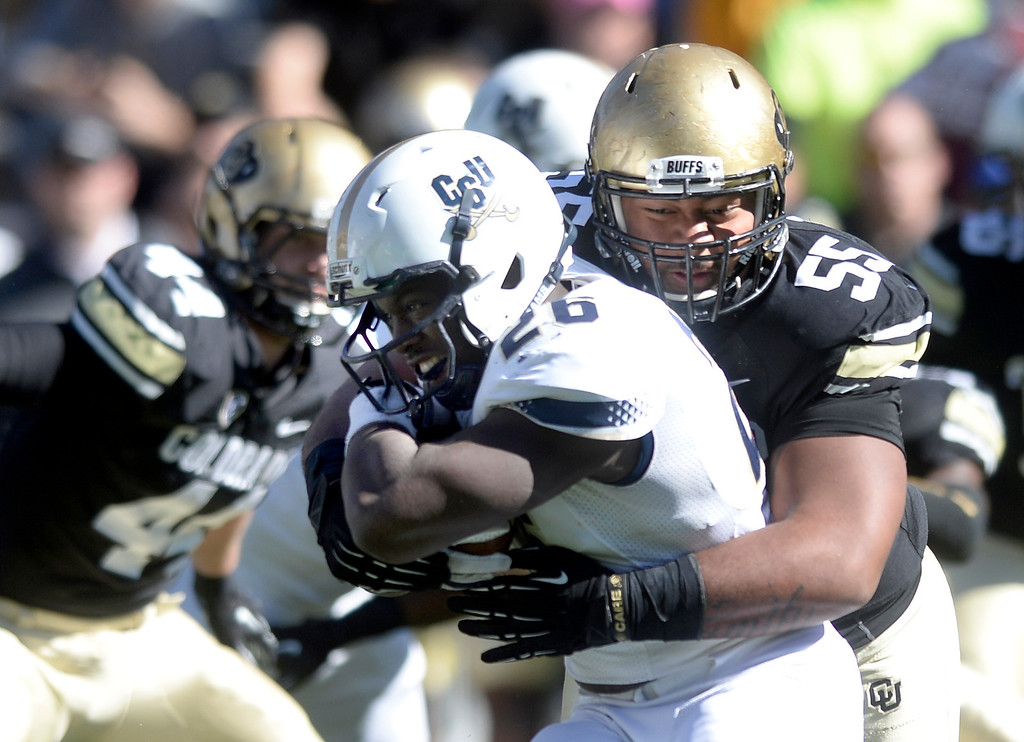 . University of Colorado\'s Josh Tupou makes a tackle on Zachary Frazier during a game against Charleston Southern on Saturday, Oct. 19, at Folsom Field in Boulder.  (Jeremy Papasso/Boulder Daily Camera)