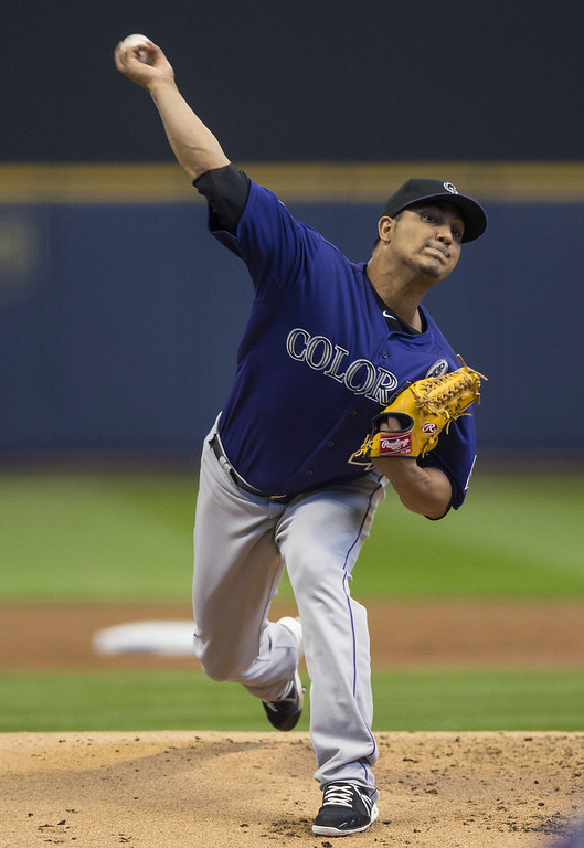 . Jhoulys Chacin #45 of the Colorado Rockies pitches to a Milwaukee Brewers batter during the first inning on opening day at Miller Park on April 1, 2013 in Milwaukee, Wisconsin.  (Photo by Tom Lynn/Getty Images)