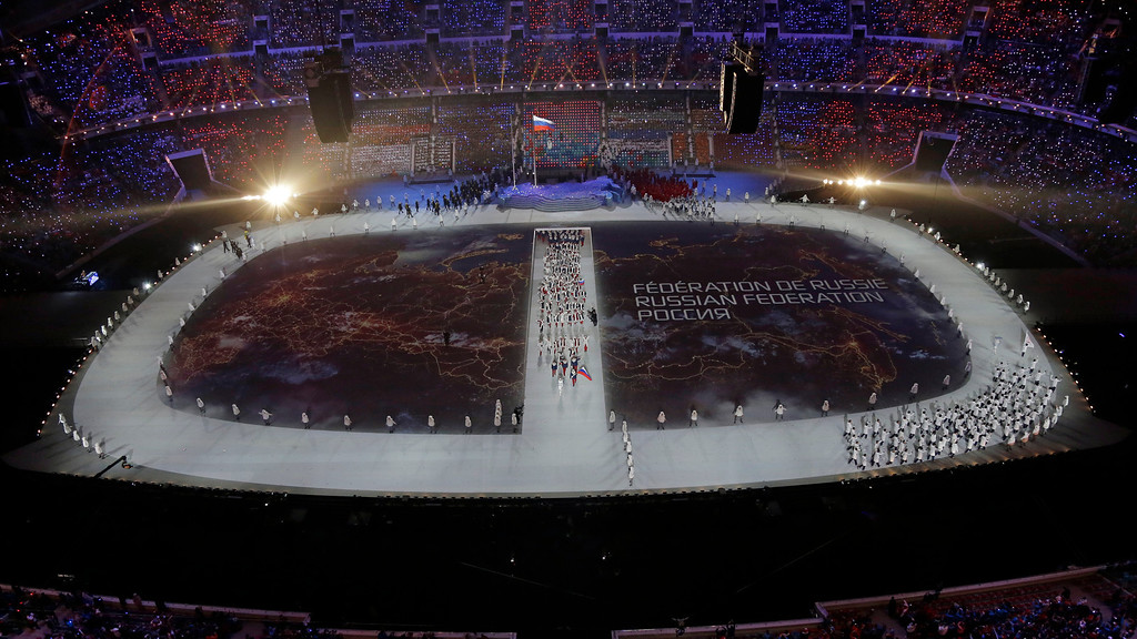 . The Russian team is introduced during the opening ceremony of the 2014 Winter Olympics in Sochi, Russia, Friday, Feb. 7, 2014. (AP Photo/David J. Phillip )